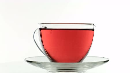 sabdariffa : Making hibiscus tea, Close up glass of a cup of tea. White background