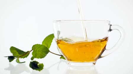 fincan tabağı : Hot herbal tea with ginger, lemon and mint. Ginger beverage in transparent teapot. Healthy lemon tea.