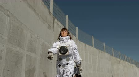 feminism : Female astronaut steps forward. Fantastic spacesuit. Exploration of outer space. Stock Footage
