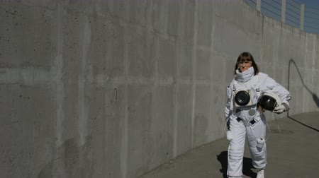 genişleme : Female astronaut steps forward. Fantastic spacesuit. Exploration of outer space. Stok Video
