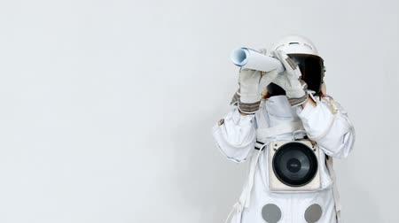 medeniyet : Portrait of a funny astronaut, looking into the distance in a telescope. on a white background.