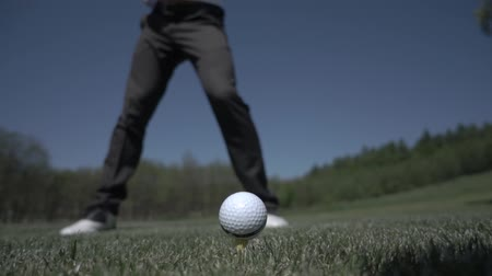 кнут : golf club hitting ball on the green artificial grass in slow motion