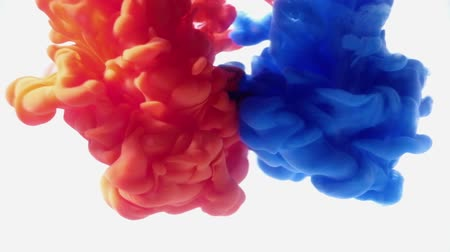 inkblot : Blue and Red Ink mixing together over a pure white background. Fantastic texture to place in your projects as luma matte or layer transfer modes to delete white background. Stock Footage