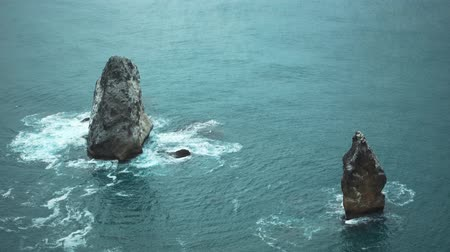 protrude : Jagged rocks protrude from sea.