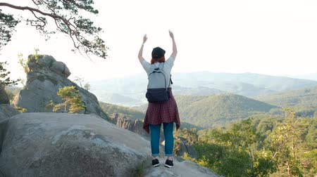 braços levantados : Woman with arms raised on top of mountain looking at view Hiker Girl lifting arm up celebrating scenic landscape enjoying nature vacation travel adventure.