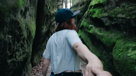 intrigue : The girl leading a man forward to the adventure. Follow me concept Stock Footage