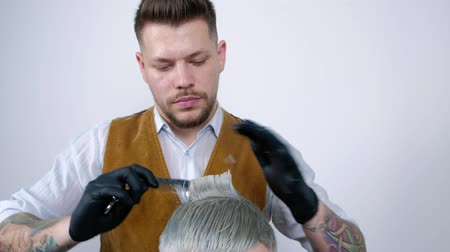 Man getting a haircut by a hairdresser. Haircut close-up of scissors