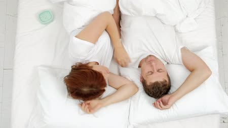 The couple does not want to get up early in the morning.