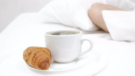 concept female sleeping on the bed and white cup of coffee. white background