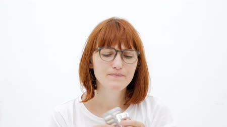 Portrait of a girl in glasses, chooses medicine