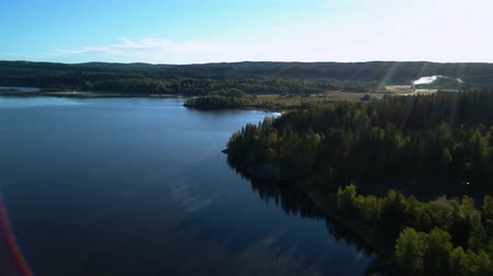 derűs : Aerial view of lake at sunset. Norwey landscape flying over lake and forest