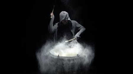 vurmalı : emotional drummer on a black background