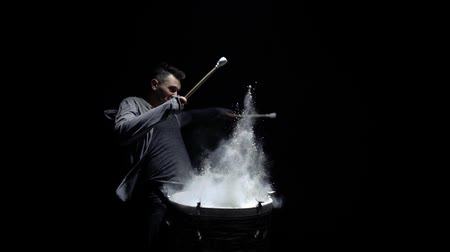 vurmalı : portrait of a drummer in profile on a black background