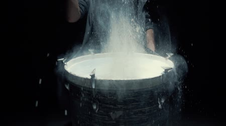 vurmalı : slow motion game on a dusty drum close up