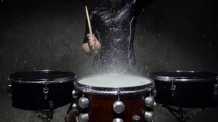 poros : drummer in the rain close up