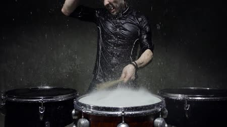 rehearsing : photo shoot crazy drummer in the rain