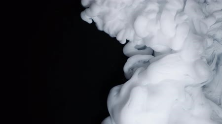 abstrakcja : White paint cloud spraying on a black background. Wideo