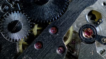 cogwheels : Watch mechanism macro loop.Old vintage clock mechanism working Stock Footage