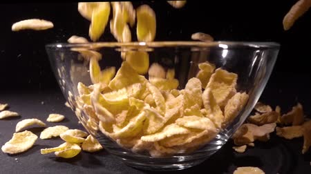 muesli : Super slow motion cornflakes falling into a bowl of milk top view Stock Footage