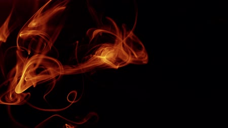мистик : Red smoke on black background. Slow motion