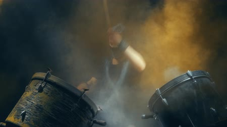 professionally : Energetic music in the performance of a professional drummer. Black background.