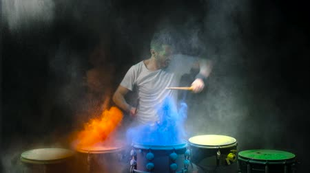bassê : Drummer playing the drum holi powder Stock Footage