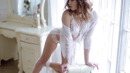 kalhotky : Beautiful sexy lady in elegant white robe