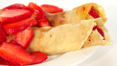 блин : Pancakes with red sweet strawberries, sweet dessert