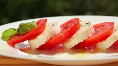 salad : Caprese salad, tomato fresh mozzarella and basil - dolly shot