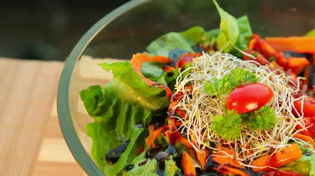 salad : Bowl of fresh vegetable salad with dressing - dolly shot