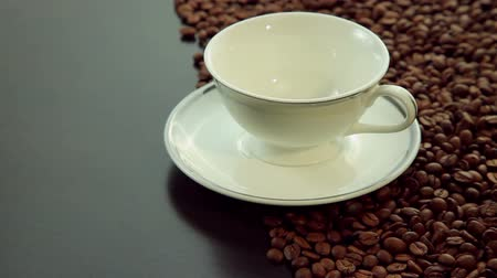 hot beverage : Empty white cup with coffee beans
