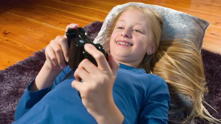 braces : Girl playing console game, shot in RAW 4K Stock Footage