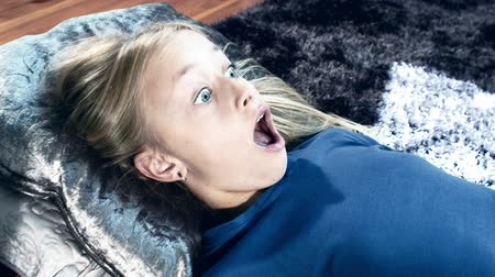 braces on teeth : Frightened girl watching scary horror movie, halloween, shot in RAW Stock Footage