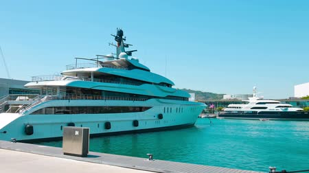 Каталония : Luxury yacht in Barcelona, establishing shot - motor yachts Стоковые видеозаписи
