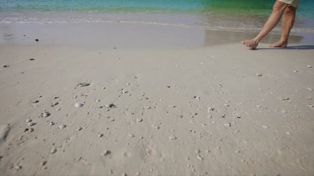 sandy waters : Video 1920x1080p - Tourist walking on the waters edge. Beach of Thailand