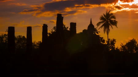 древний : Video 1920x1080 - Silhouettes of the ruins of ancient temples at sunset. Thailand. Sukhothai