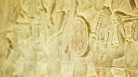резной : Video 1920x1080 - Ancient carvings on the walls of Angkor Wat. Cambodia. 12th century Стоковые видеозаписи