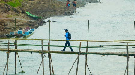 prabang : LUANG PRABANG. LAOS - CIRCA DEC 2013: Bamboo bridge over a small river. Convenient way for tourists