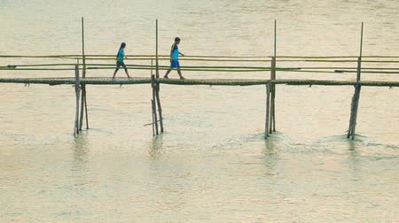 prabang : LUANG PRABANG. LAOS - CIRCA DEC 2013: Bamboo footbridge across the river length of about 40 meters