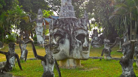 editorial : VIENTIANE. LAOS - 13 DEC 2013: Stone statues in Buddha park also known as Xieng Khuan sculpture park Stock Footage