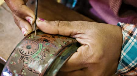 lacquerware : BAGAN. MYANMAR - 10 JAN 2014: Etching with needle in traditional Burmese lacquerware handmade. Yun-de is lacquerware in Burmese. and the art is called Pan yun.