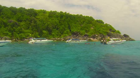 speedboats : SIMILANS. THAILAND - CIRCA MAR 2014: Speedboats are anchored while tourists snorkle in the sea Stock Footage