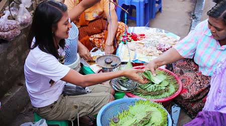 betel : YANGON. MYANMAR - 03 JAN 2014: Paan (betel leaves) trade on the street