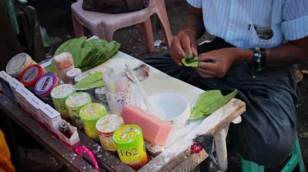 betel : YANGON. MYANMAR - 03 JAN 2014: Production and sale of Bettel on the street Stock Footage