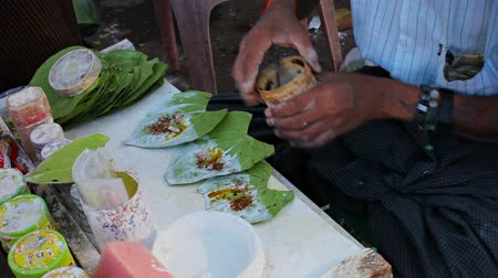 betel : YANGON. MYANMAR - 03 JAN 2014: The process of manufacturing Bettel on the street for sale Stock Footage
