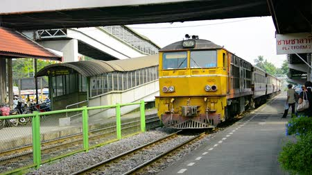 modern train wagon : DONG MUEANG. THAILAND - 22 NOV 2014: Train station with passenger apron. Arrival of a train with diesel locomotive