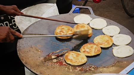 prepare food : Video 1080p - Cooking pancakes on the street for sale. Burma. Yangon