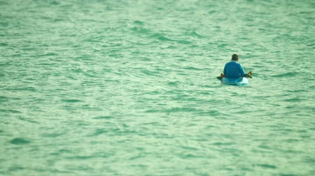 kayak : PHUKET. THAILAND - CIRCA OCT 2014: A local man fishes in the sea on a kayak
