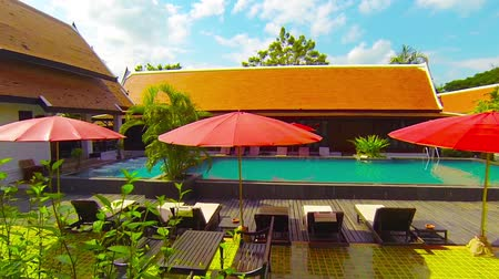 repousante : Video FullHD - Left-to-right. tracking shot of the saltwater swimming pool and wooden deck at the beautiful Legendha Sukhothai Resort in Thailand