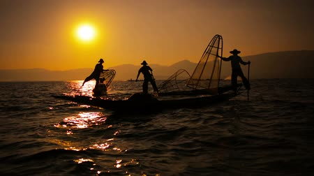 fishermen : Video FullHD - Silhouettes of fishermen at sunset. Ends fishing in the traditional way. Inle Lake. Myanmar